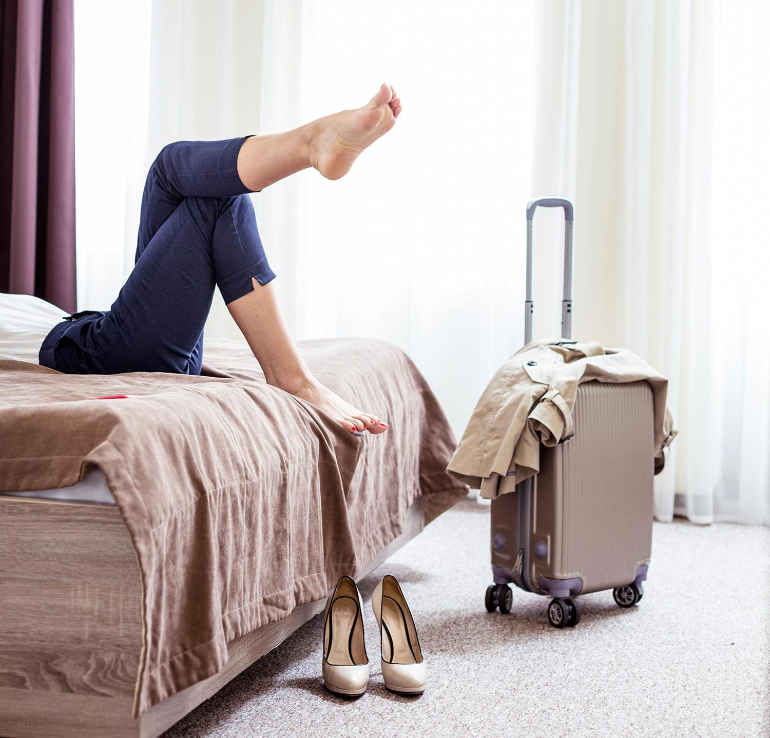 woman hotelroom suitcase