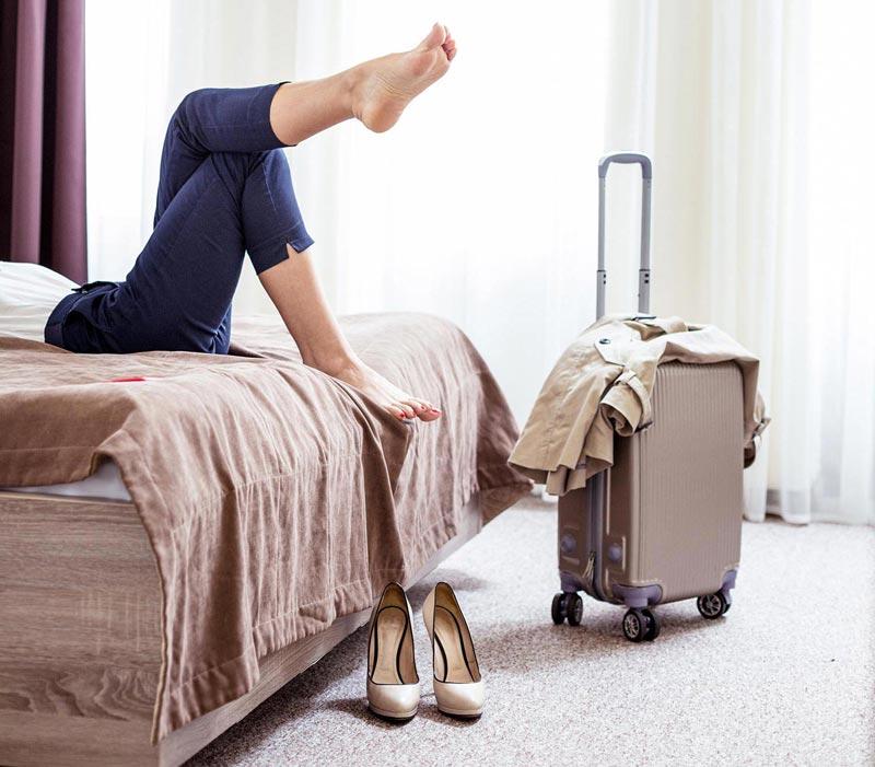 woman hotelroom suitcase